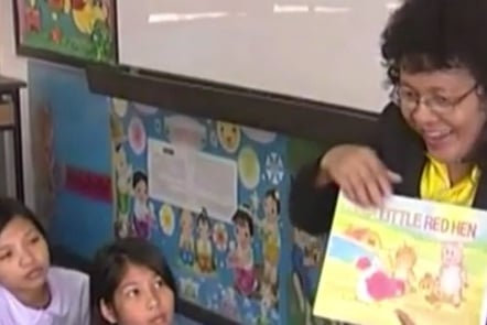 A teacher reading a story to her class