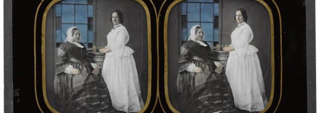 Stereo ambrotype, glass, depicting two unidentified women, one seated and one standing, the latter holding a plant on a plinth, by Charles F. Ravis, Bristol, 1857 – 1859/ IL.2003.44.1.162 © Howarth-Loomes Collection at National Museums Scotland