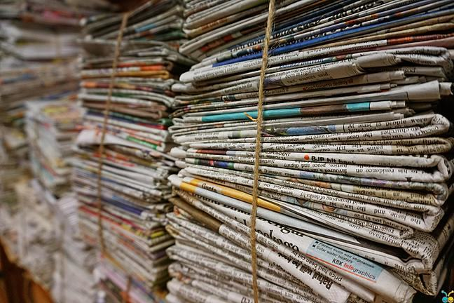 A photograph of a stack of newspapers
