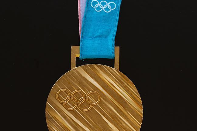 Olympic gold medal on a blue ribbon