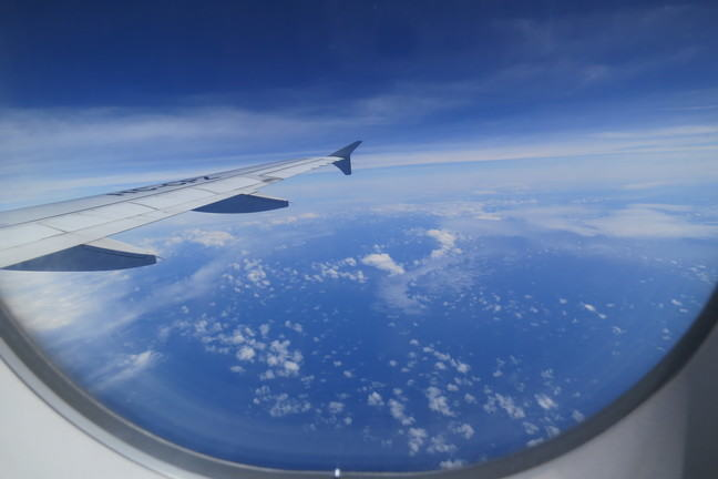 the view from the window of a plane in air