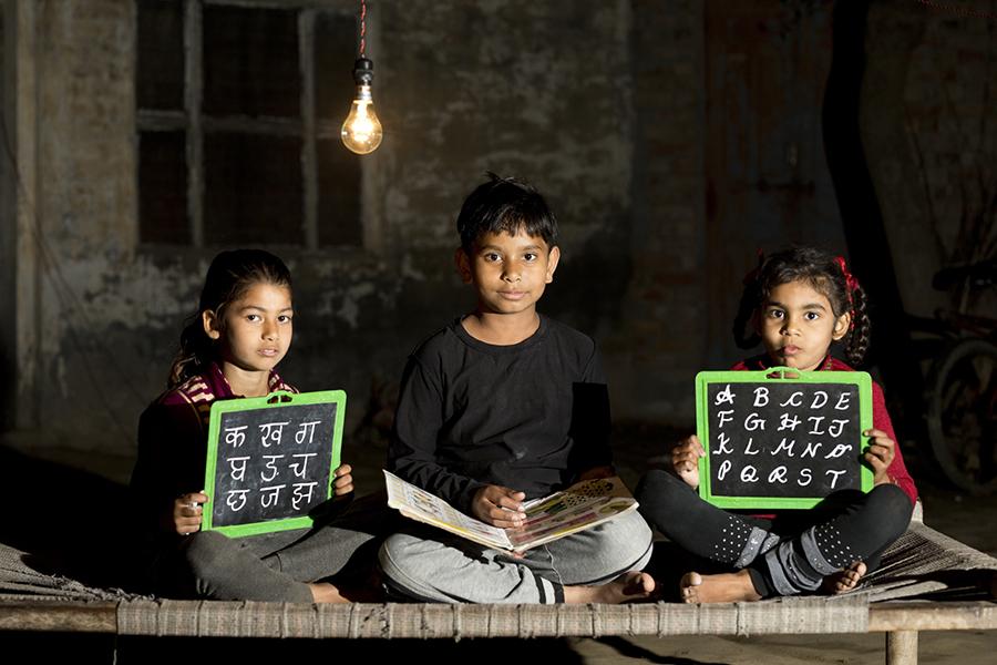 developing nation children doing homework at night