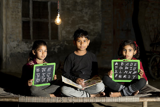 developing nation children doing homework at night