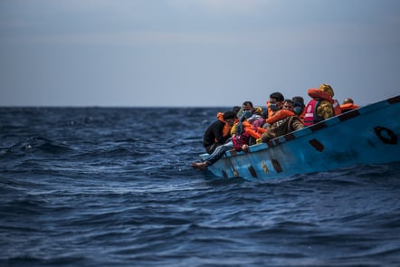 A wooden boat with 38 migrants of various nationalities.