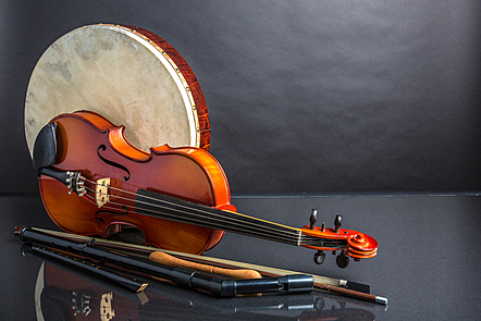 A collection of traditional Irish musical instruments including a violin.