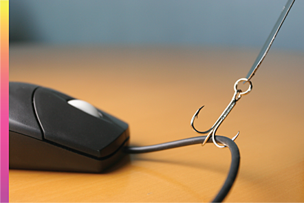 Photographic image of laptop mouse being pulled by a fishing hook