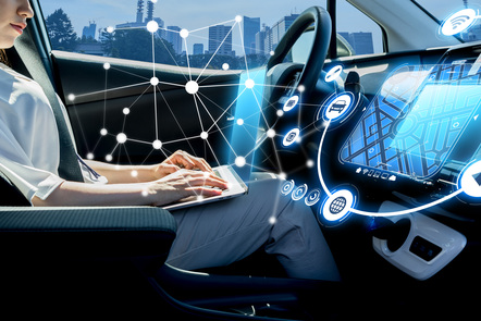 Woman in car using data and communication networks