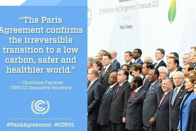"Twitter post, showing world leaders at the COP21 in Paris, France. ""The Paris Agreement confirms the irreversible transition to a low carbon, safer and healthier world."""