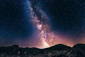 A starry night sky above a mountain range