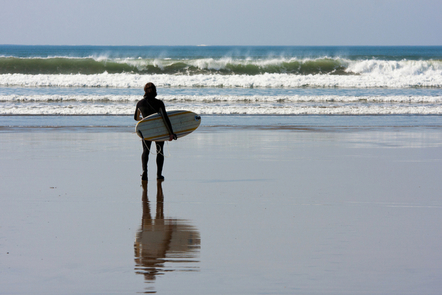 A woman on a surfboard.