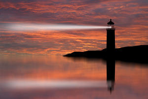 Image of lighthouse beam shedding light on local landscape