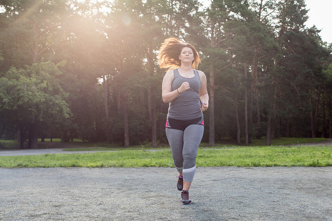obese woman jogging