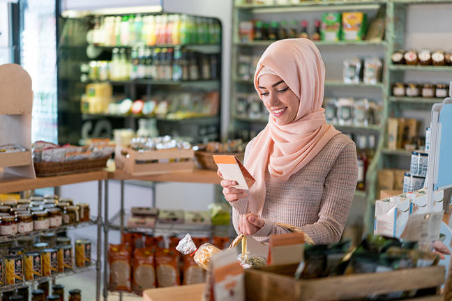 Muslim woman shopping at the grocery shop