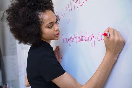 Teacher writing at the board
