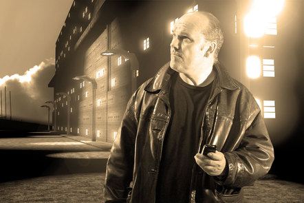 Film Noir style scene of man in leather jacket holding a mobile phone in front of a building