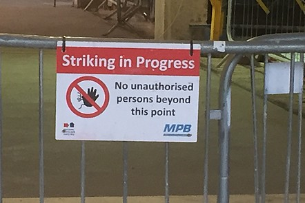 'Striking in Progress' sign (but not striking as industrial action!).