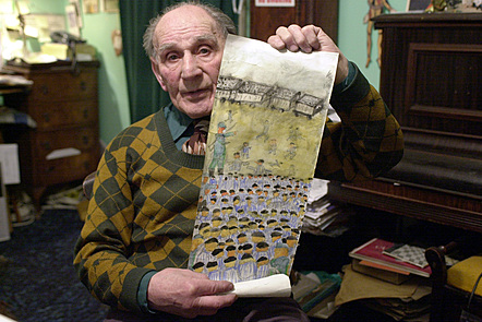 An image of  Holocaust survivor Leon Greenman showing some of his artwork.