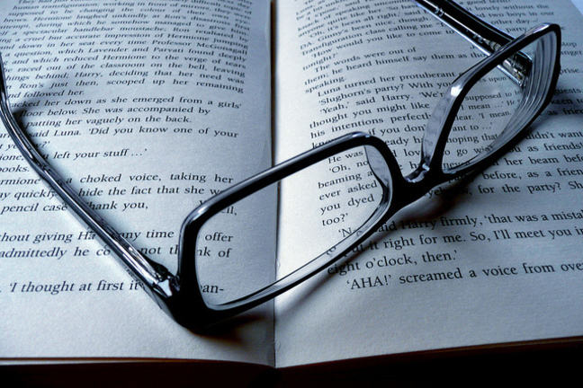 Spectacles resting on an open book