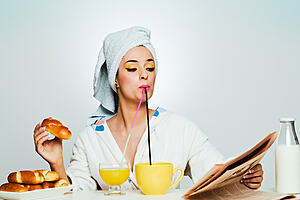 A woman eating breakfast