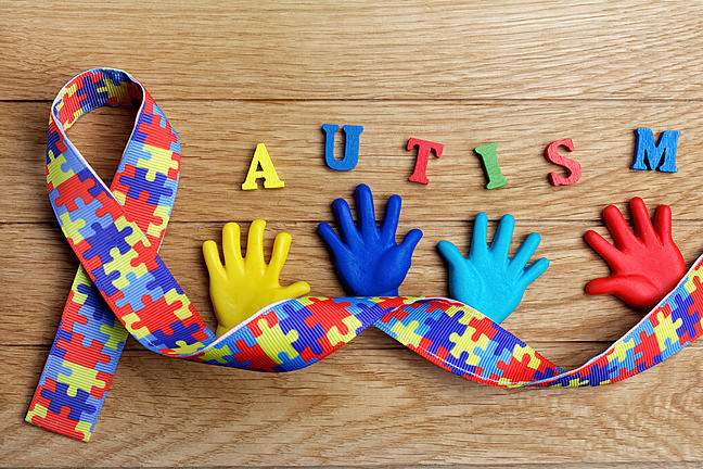 Autism hands and ribbon