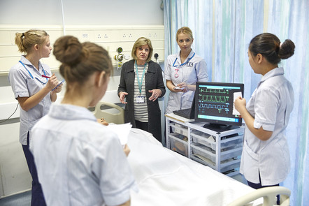 Nurses being taught on a hospital ward