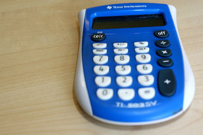 Blue calculator on a desk