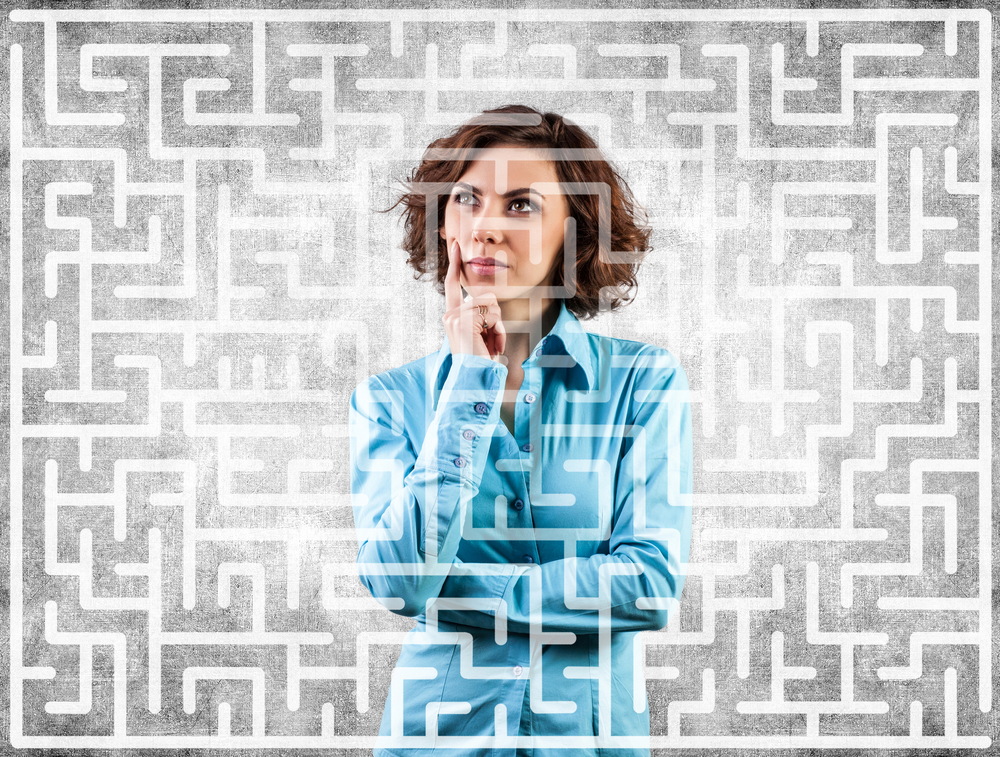 A woman thinking surrounded by a maze