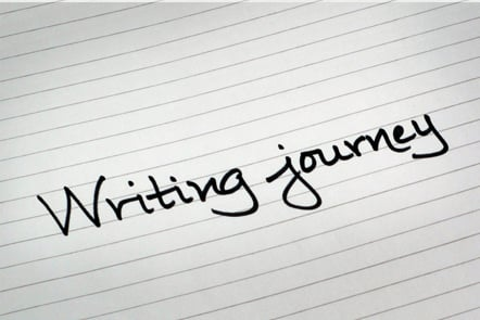 A page with the words 'Writing journey' written down.