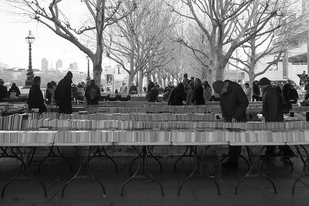 People browsing at Southbank book market, London.