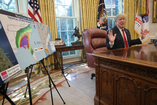 U.S. President Donald Trump discusses the potential impact of Hurricane Michael during a meeting with Homeland Security Secretary Kirstjen Nielsen and FEMA Administrator Brock Long in the Oval Office of the White House.