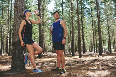 Marathon participant drinking water.