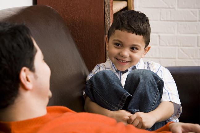 Boy smiling at man