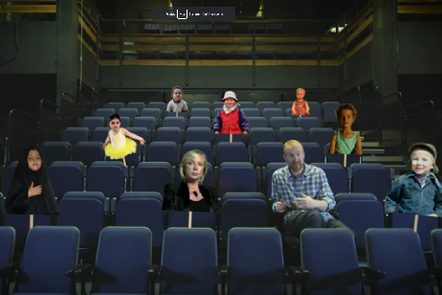 Dave Jarman in a theatre, surrounded by cutout signs of various people.