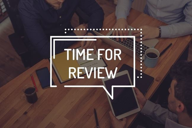 People sitting at a desk with the words time for review overlayed.