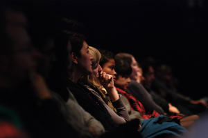 Audience in a cinema watching a film