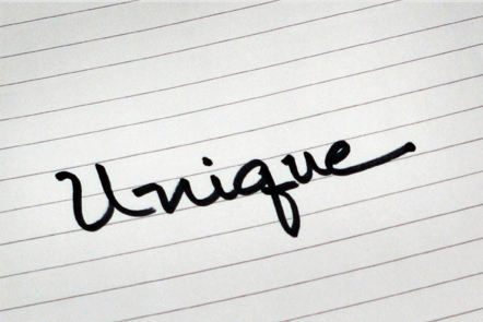 A page with the word 'Unique' written down.