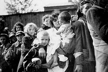 Women and children during deportation, Szydlowiec, Poland, 1942