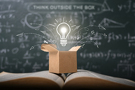 Light bulb emerging from a box. Thinking outside the box.