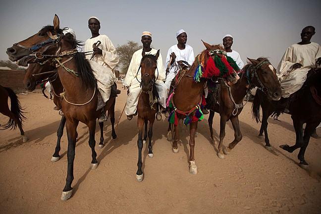 Community members from El Sereif, North Darfur, on horseback