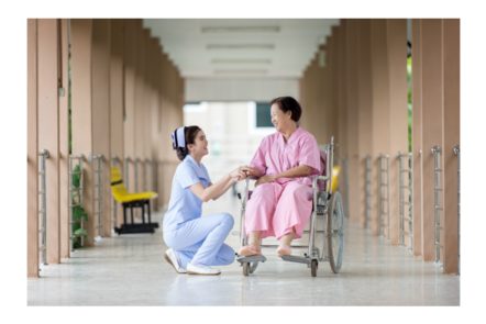 healthcare worker and patient in a wheelchair by flickr (BA-SA)License