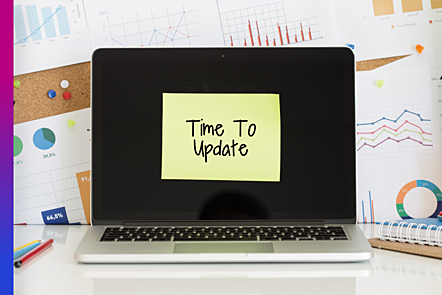 Photographic image of a laptop with a yellow paper stuck on the screen with the written text 'time to update'