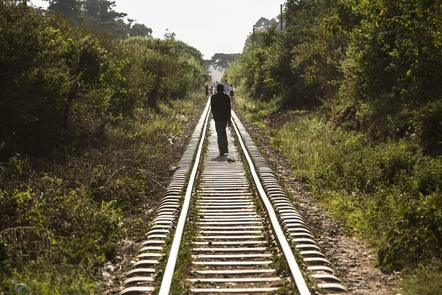 A person walking on train tracks near Nairobi in Kenya