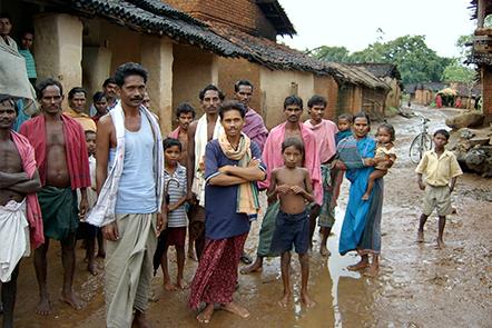 Group of people in muddy village street