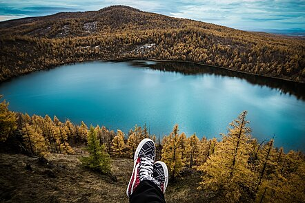 A person gazing out over a beautiful lake