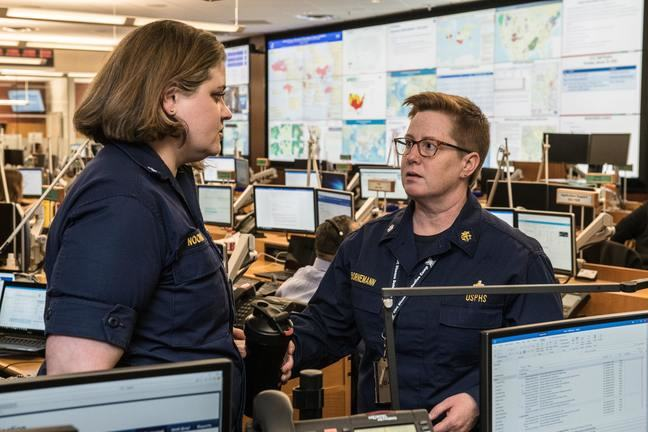 Image showing two members of the Center for Disease Control and Prevention (CDC) Emergency Operations Center (EOC)
