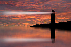 Image of lighthouse beam shedding light on local landscape