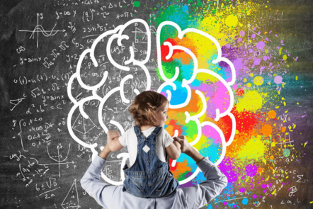 Child sitting on shoulders drawing a brain on a chalk board