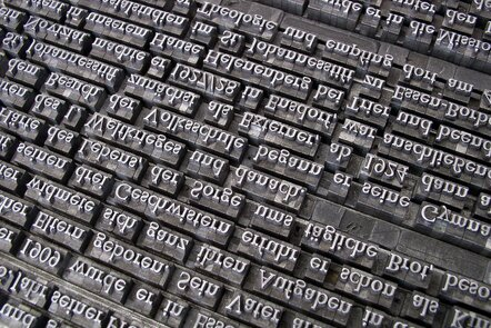 Close up photo of metal type for printing.