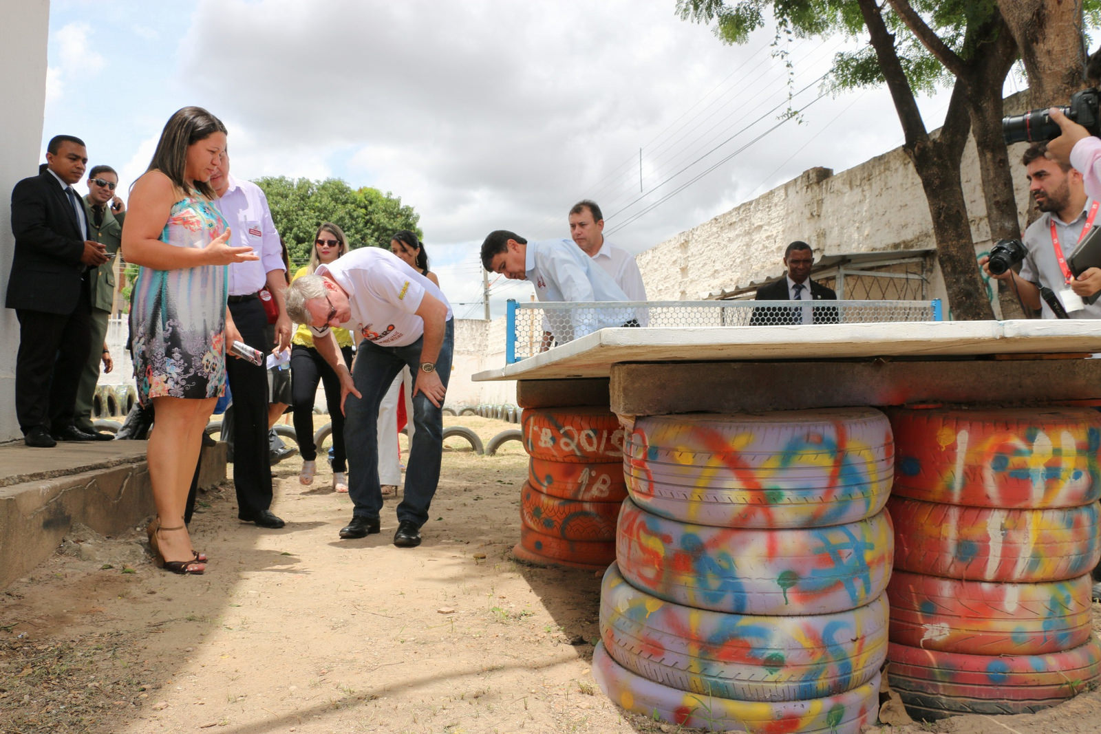 Image of government officials looking at tyres