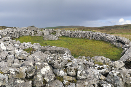 Picture of Cloghanmore, a megalithic chamber tomb of the court tomb (or court cairn) type located about 8 km east from Carrick in Malin More, Glencolmcille, in County Donegal.